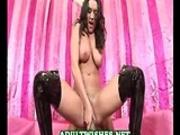 Big tit brunette rides a black cock