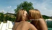 Lesbian babes near a pool kissing and licking eachother