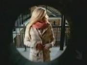 Woman strips in front of the wrong door.