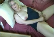 Busty mature toying.