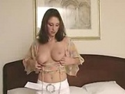 Brunette MILF stripteases!