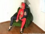 Hot Rubber Babe Spreading Legs