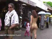 crazy redhead has fun nude in public