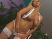 Amazing blonde with nice jugs plays alone