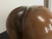Fat ebony MILF shows off her oily ass