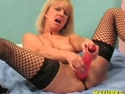 mature lady enjoy a dildo and a black cock