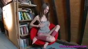Teen chick strip and show trimmed pussy on a chair