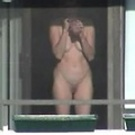 Voyeur caught neighboor naked on the balcony
