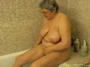 Hot granny having fun in the bath