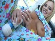 Bree Olson playing with her blue toys