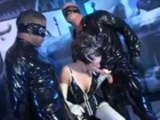 Latex slut fucks two guys