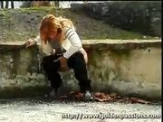 Mature redhead peeing on the streets with people around