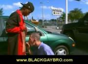 Black gay bro on his knees gives public blowjob in parking lot