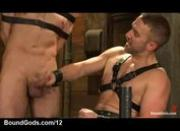 Strapped gay gets handjob until cum from gay in leather