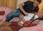 Slim brunette teen lies on her side
