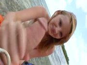 strawberry blond chick giving bj in the nude beach
