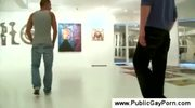 Public gay blowjob in an art gallery