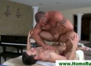 Muscular masseuse taking a facial