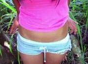 Asian chick masturbating in forest