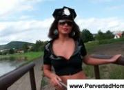Brunette dressed as a cop serving a bj