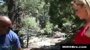 Hiking blonde MILF sucks big black cock in the forest