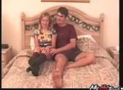 - This couple sits on their bed as she gives you an