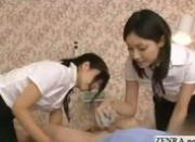Japanese estheticians rub pantyhose across clients hardon