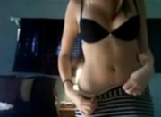 Skinny teen stripping to music