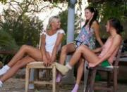 Threesome lesbians making love