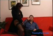 Hung guy gives blowjob to slutty brunette tranny wearing lingerie and stockings.