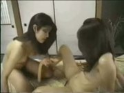 Asian Lesbians with a Double-ended Dildo