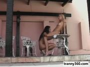 Two very hot shemales fuck on the balcony