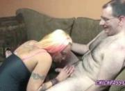 Tattooed Lexxi on her knees and blowing a geek