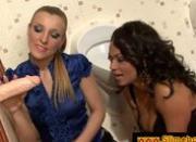 Two sluts sucking a fake dick