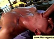 Masseuse has his cock sliding in a mouth