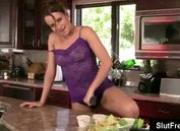 Hot babe Jenna masturbates with spoon in the kitchen