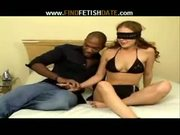 Redhead slut fucks blindfold with a black guy