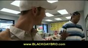 Horny white queer sucks a big black dick in a store