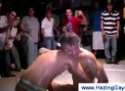 Sweaty college guys wrestling each other