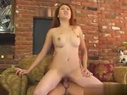 Sin Nye is a redheaded Asian who is outdoors pul