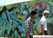 Guys make grafitti of a big angry penis