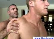 Man getting a massage from another man