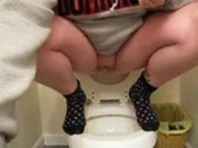 Piss peeing in toilet