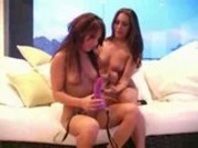2 lesbians having fun with strap on