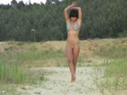 BikiniHeat - Pierced girl is doing a strip walk