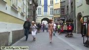 Naked redhead has fun in public streets