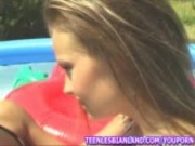 Two hot girls fuck each other in the backyard pool