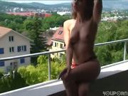 Naked brunette by beautiful view