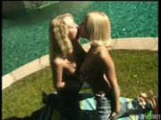 Two hot blondes get frisky by the pool