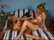 Two girls in a 69 licking and kissing